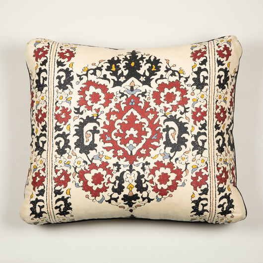 A pair of large rectangular cushions made up in a fabric based on a traditional Algerian pattern in red and black on a cream ground. £410.00 each + vat.