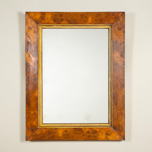 A rectangular mirror with a mid-20th century burr oak wide edge frame. With a replacement mirror plate.