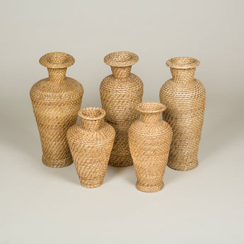 A collection of basket-weave vases of differing heights. 20th century. £350 each.