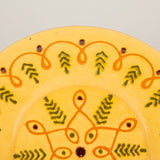 An attractive Biot pottery charger decorated in coral and black on a yellow ground. French, mid-20th C.