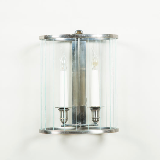 Four elliptical cylindrical steel and glass wall lanterns, mid-20th century.