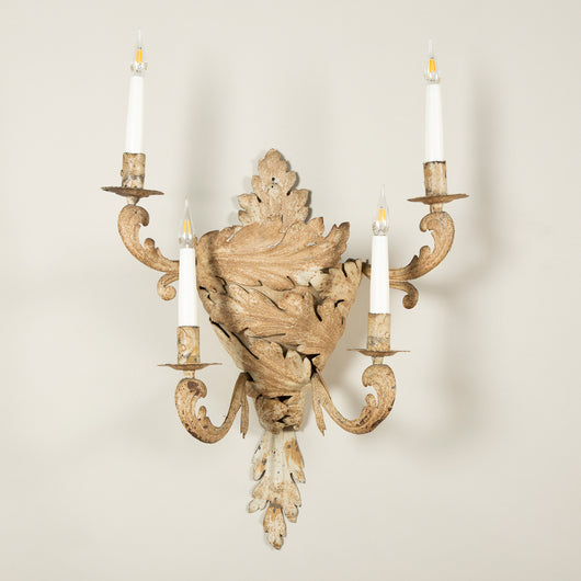 A pair of painted wrought iron four-branch wall lights in the form of scrolling stylised acanthus leaves, early 20th century.