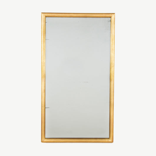 A late 19th century rectangular mirror with a simple rounded gilt frame and original mirror plate.
