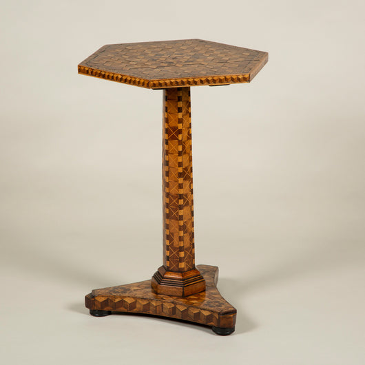 A small marquetry covered hexagonal table with central support and triform base, circa 1820. Lovely colour and patination.