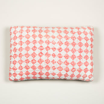 A pair of cushions made up from a panel of vintage quilted red and white chequerboard patterned fabric. £220.00 each.