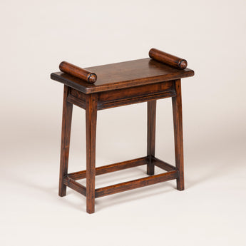 A stained wooden scroll top stool or table, late 19th century.