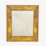 A small rectangular mirror with a cedar-edged mottled verre eglomise frame.