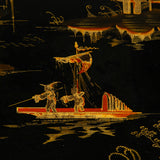 A large Regency period rectangular papier mache tray with Chinoiserie scenes in gilt on black, circa 1820.