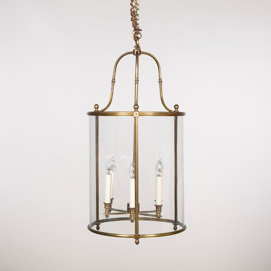 A brass cylindrical hanging lantern in a simplified Louis XVI style, mid 20th century.