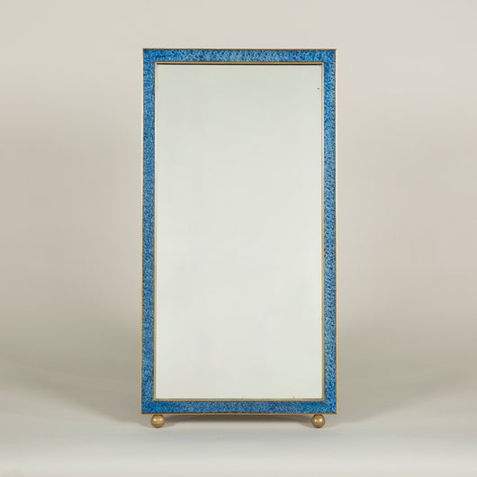 A narrow rectangular dressing-table mirror with a painted faux lapis lazuli frame and gilt ball feet.
