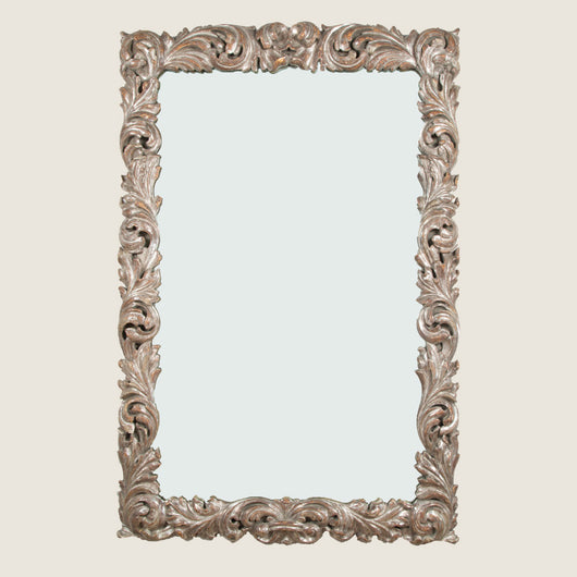 A rectangular mirror with an early 18th century style carved wood and silver gilt frame, 20th century.