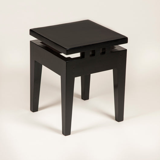 A low, square ebonised table in a style reminiscent of Charles Rennie Mackintosh. 20th century.