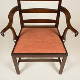 A George III mahogany ladder-back elbow chair with rope twist edges to the back and out-turned arms.