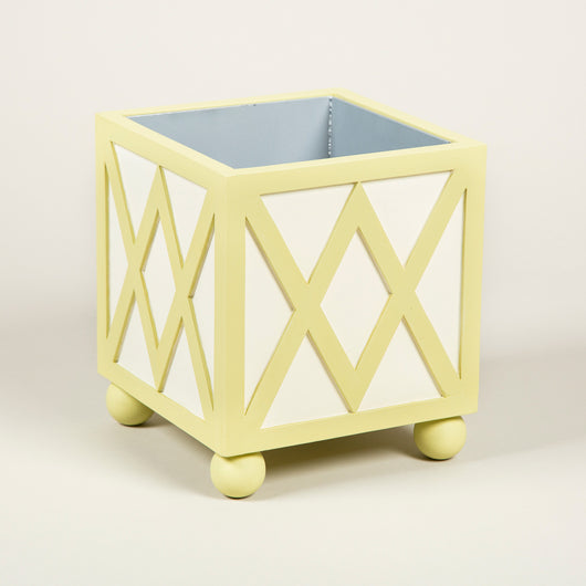 A square painted wooden planter with trellis details to the sides and mounted on ball feet, with a metal liner. Can be bespoke painted to any colour scheme on application. £640.00 each + vat.