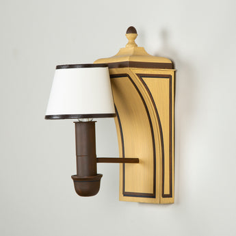 A pair of wooden Colefax and Fowler Chatsworth wall lights in a dragged brown finish with bespoke half-shades.