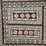 A large framed antique painted tapa-cloth panel from the Solomon Islands. Tapa-cloth is made from the bark of the dye-fig tree which is indigenous to Oceania.