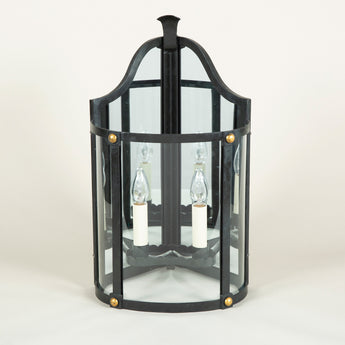 A pair of wrought iron corner wall lanterns in a black painted finish with gilt details. £3,400.00 each