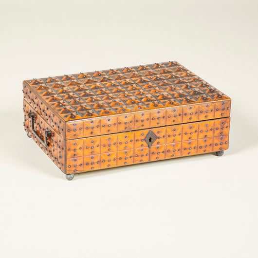 A rectangular facet-carved fruitwood box with steel pinhead decoration. 19th century, probably French.