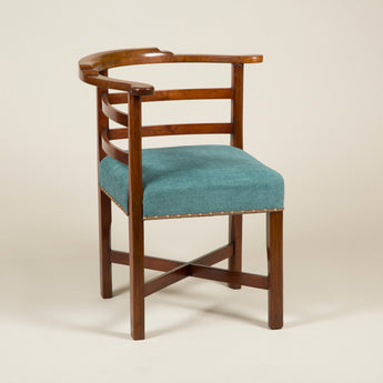 An early 19th century walnut corner chair with simple horizontal back-splats.