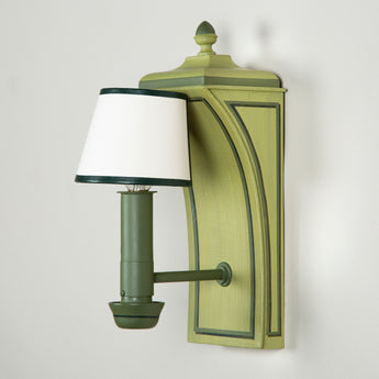 A pair of painted Colefax and Fowler Chatsworth wall lights in a dragged green finish and with bespoke half-shades.