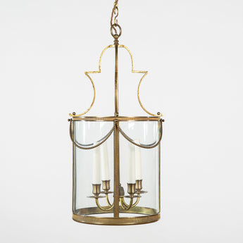 A 1940's French cylindrical brass lantern with beaded swag decoration.