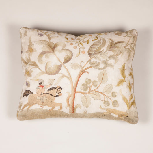 A rectangular cushion faced with a 19th century needlework panel depicting a hunting scene.