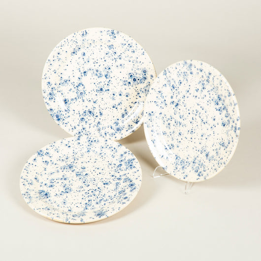 Plates decorated with a splattered blue pattern on a cream ground. £84 inc vat each.