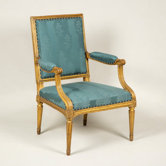 A square backed gilt wood open armchair in the Louis XVI style. Circa 1790, probably English.