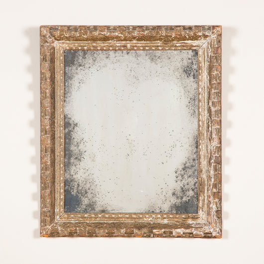 An early 20 century rectangular gessoed wood mirror with distressed plate glass.