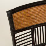 A low Japanese side chair with a slatted frame and caned back and seat early 20th century.
