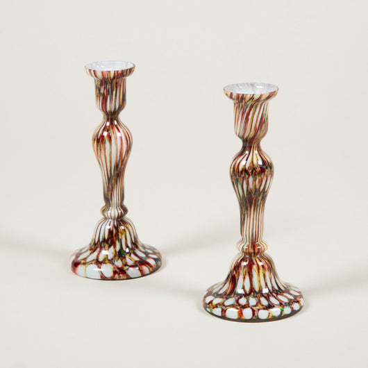 A pair of early 20th century tapering coloured glass candlesticks. English circa 1900.