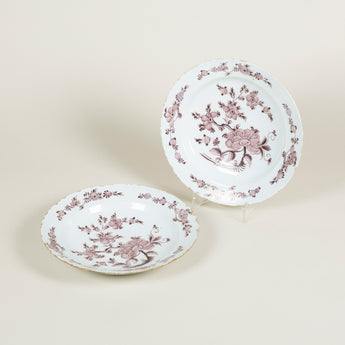 A pair of English Delft manganese glazed chargers decorated with flowers, mid 18th century.