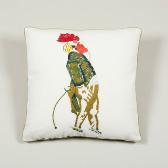 A needlepoint cushion of a cockerel in breeches inspired by Nancy Lancaster's tablecloth at Ditchley depicting animals from J.J. Grandville fable 'Scenes de la vie privees et publiques des animaux'. £650.00 plus vat.