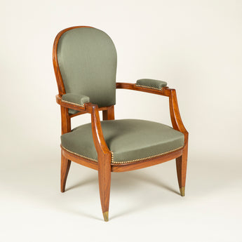 A pair of 1930's French rosewood open armchairs with arched backs and tapered legs.