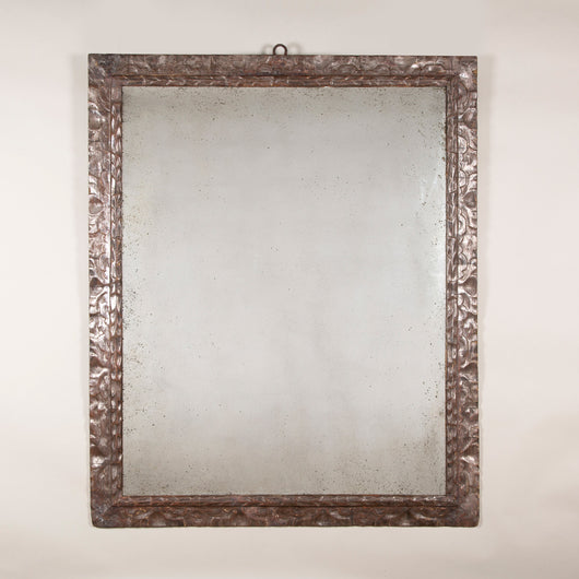 A rectangular mirror with 17th century Spanish silvered wood frame. With a modern mirror plate.
