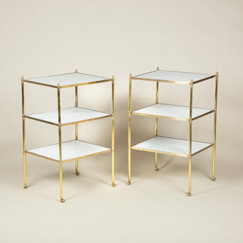A pair of rectangular brass-framed three tier tables with inset marble tiers. 20th century.