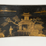 A rectangular Chinoiserie decorated box with incurved sides and fitted interior, circa 1820.