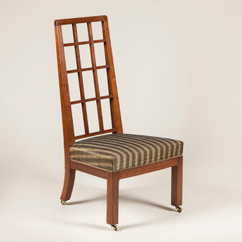 A low Australian walnut chair with high lattice back and upholstered seat. Designed by Betty Joel circa 1930.