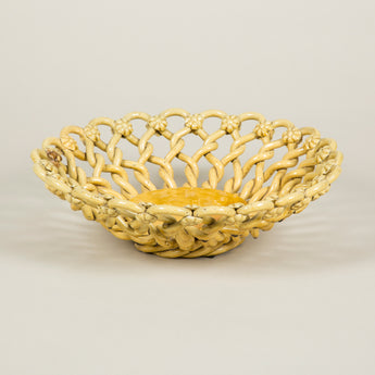 A Vallauris pottery lattice fruit bowl with a mustard yellow glaze. French, second half of the 20th century.