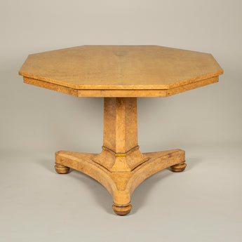 An exceptional early 19th century amboyna wood table with an octagonal top, elegant hexagonal column support and triform base. English, circa 1830.