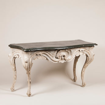 A pair of painted baroque console tables.
