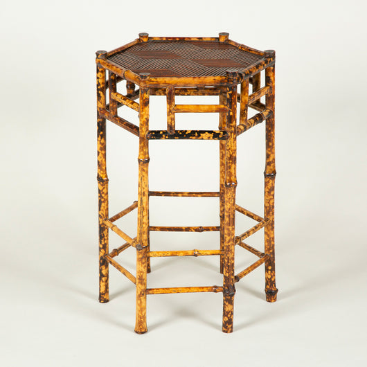 A small 19th century hexagonal bamboo table, the top covered in lozenges of finely-cut bamboo in a star pattern. Probably circa 1890.