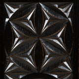 An ebonised oak hexagonal table, the sides carved with geometric roundels. Circa 1900; later ebonising.
