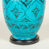A turquoise glaze vase with fine painted black formalised floral decoration, Persian 19th or 20th century, now wired as a lamp.