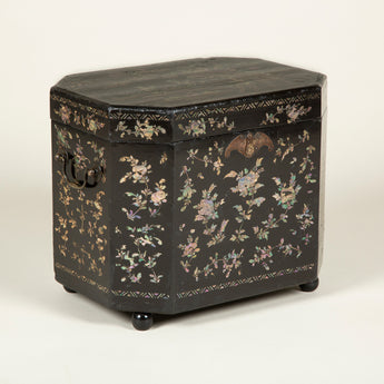 A small octagonal late 18th or early 19th century lac burgaute tea box, now raised on ball feet.