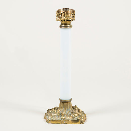 A 19th century Palmer style opaline column lamp with brass mounts, wired for electricity.