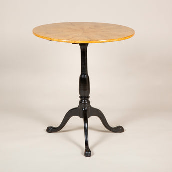 A late 18th early 19th century Swedish tripod table with a segmentally veneerd Masur birchwood top and ebonised base