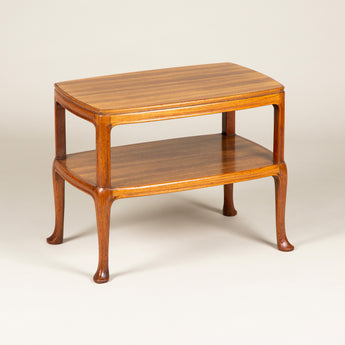 A pair of low two-tier padouk-wood tables by Whytock & Reid, Edinburgh. Mid-20th century.