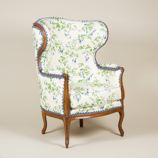 A large Louis XV upholstered walnut wing bergere with cabriole legs, French circa 1770.