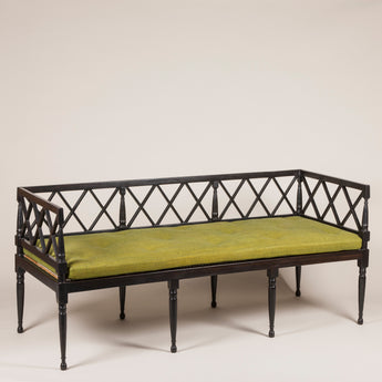 A pair of 20th Century ebony settees with lattice backs and arms and caned seats. Price each
